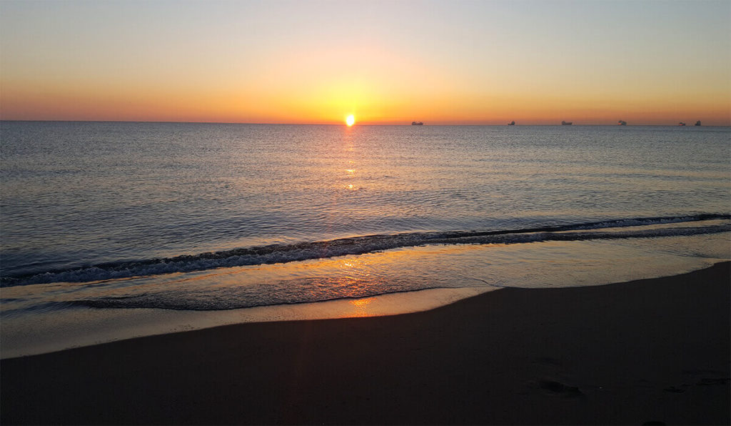 Orange sunrise at Levante beach, La Linea